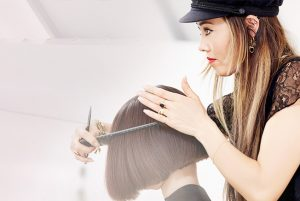 Beau Monde student giving a client a great style during Cosmetology training