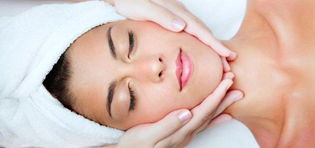 A Beau Monde Esthetics Professional giving a facial to a client.